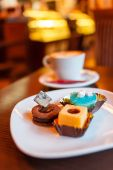 Coffee with candies — Stock Photo