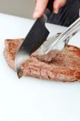 Cooking  juicy steak — Stock Photo