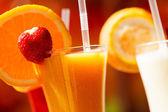 Fresh juice in glasses — Stock Photo
