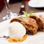 Apple strudel with ice cream — Stock Photo #64089587