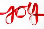 Red ribbon Joy word — Stock Photo