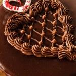 Chocolate heart shape cake — Stock Photo #64560581