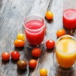 Fresh tomato juice and small tomatoes — Stock Photo #65832725