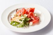 Salad with ham on plate — Stock Photo