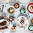 Sweets and cakes on saucers — Stock Photo #66018045