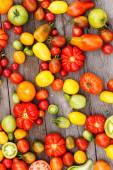 Colorful tomatoes background — Stock Photo