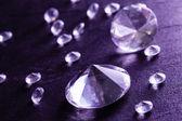 Different diamonds with purple light — Stock Photo