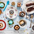 Sweets and cakes on saucers — Stock Photo #66160000