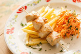 Chicken skewers with fries — Stock Photo