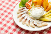 Tasty herring with vegetables — Stock Photo
