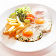 Breakfast with french fries and eggs — Stock Photo #67692001