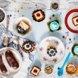 Sweets and cakes on saucers — Stock Photo #67784847