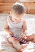 Baby with tablet PC — Stock Photo