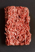 Minced meat on black — Stock Photo