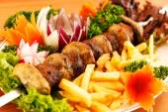 Kebab on skewers with vegetables — Stock Photo