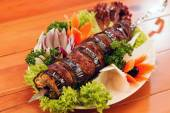 Kebab on skewers with vegetables — Photo