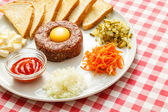 Tartare meat with egg yolk — Stock Photo