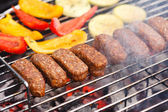 Grilled kebab and vegetables — Stock Photo