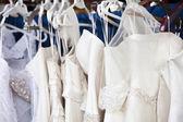 Wedding dresses in shop — Stock Photo