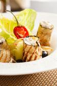 Eggplant rolls on plate — Stock Photo