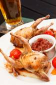 Baked quails with sauce — Stock Photo