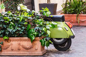 Scooter parked in street — Stock Photo
