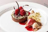 Chocolate cake with raspberries — Stock Photo
