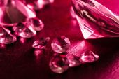 Different diamonds with red light — Stock Photo