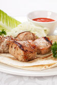 Pork on pita bred with sauce — Stock Photo