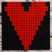 Heart of red plastic bricks — Stock Photo