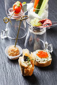 Tasty canapes with fish — Stock Photo