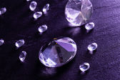 Different diamonds in purple light — Stock Photo