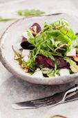 Beetroot salad with cheese in bowl — Stock Photo