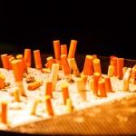 Ashtray full of cigarettes — Stock Photo #80318120