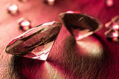 Different diamonds on red background — Stock Photo