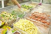 Prepared vegetables and seafoods in shop freezer — Stock Photo
