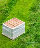 Stack of brick paving on the grass — Stock Photo
