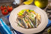 Grilled anchovy on the plate — Stock Photo