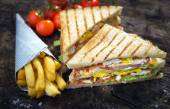 Club Sandwich and french fries — Stock Photo