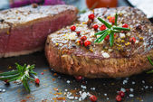 Juicy Fillet Steak with Fresh Herbs — Stock Photo