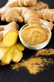 Ginger on wooden table — Stock Photo