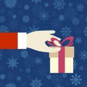 Hand mit ein geschenk — Stockvektor