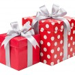 Red boxes gifts tied with gray bows isolated on white — Stock Photo #54956033