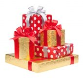 Red, striped and gold boxes with gifts tied bows on white — Stock Photo