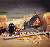 Wood planer and shavings — Stock Photo