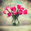 Pink tulip flowers in jug. — Stock Photo #61811649