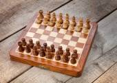 Chess board on wooden background — Stok fotoğraf