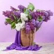 Lilac flowers in vase — Stock Photo #64997541