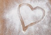 Heart of the flour on the table — Stock Photo