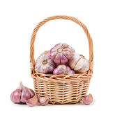 Garlic cloves in basket — Stock Photo